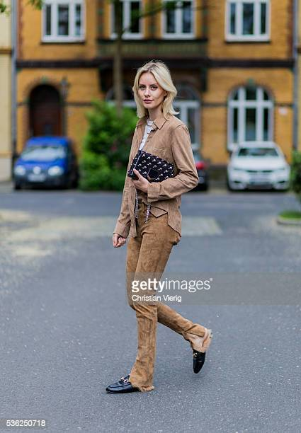 Lisa Hahnbueck wearing a suede button shirt and pants from Set a black Jimmy Choo bag Gucci slippers on June 1 2016 in Duesseldorf Germany