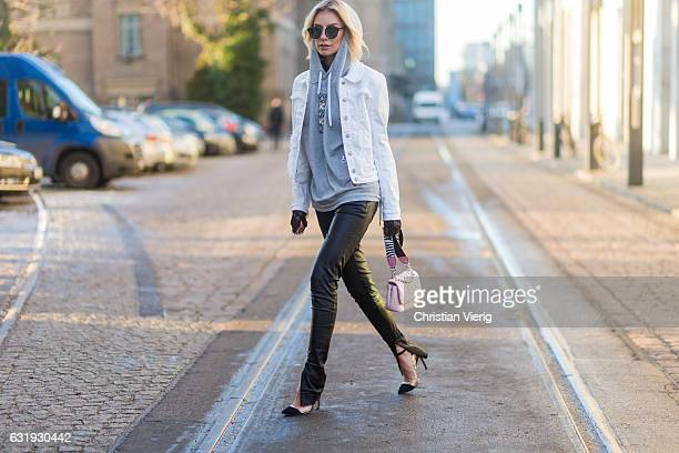 Lisa Hahnbueck wearing a white Marc Cain jacket grey Marc Cain hoody pink Marc Cain bag leather pants Marc Cain heels sunglasses during the...