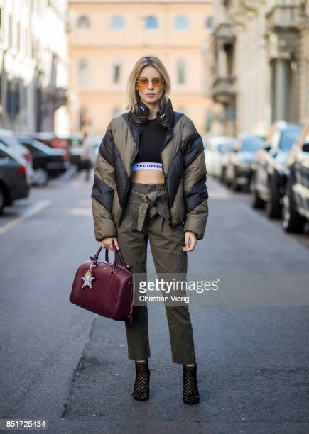 Lisa Hahnbueck wearing an olive Public School down feather jacket Paco Rabane cropped tshirt Frame denim pants Christian Louboutin heels MCM bag is...