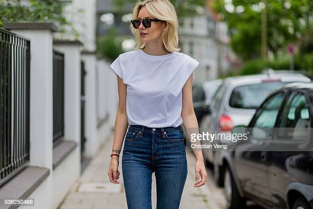 Lisa Hahnbueck wearing black Celine sunglasses a white Levis tshirt and navy Levis denim jeans on June 1 2016 in Duesseldorf Germany