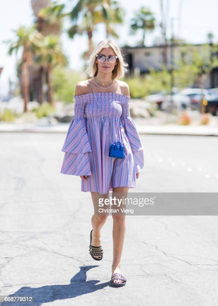 Lisa Hahnbueck wearing Caroline Constas dress with statement sleeves Chanel slipper MCM Milla phyton credit card bag Fendi sunglasses Ariane Ernst...