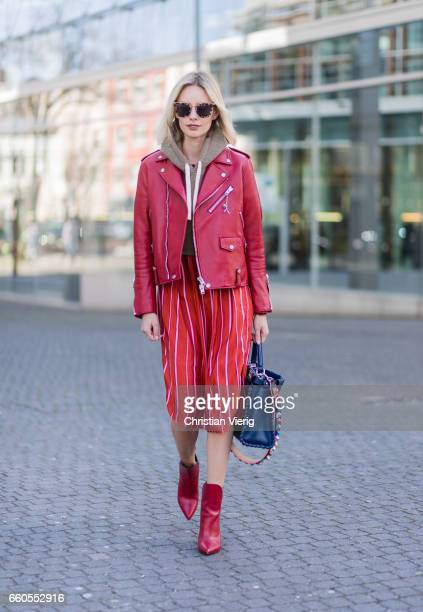 Lisa Hahnbueck wearing Coach ICON Moto Leather Jacket Kith Cropped Sweatshirt Stine Goya Marnie Silk Shirt Louis Vuitton Pokerface Ankle boot Fendi...