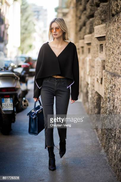 Lisa Hahnbueck wearing Diane von Furstenberg jacket Mother Denim copped jeans Dior ankle boots Fendi peekaboo bag is seen during Milan Fashion Week...