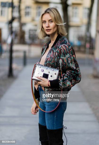 Lisa Hahnbueck wearing Drykorn Reversible Bomber Jacket Drykorn Sweatshirt Mango Jeans Stuart Weitzman Alllegs Over Knee Boots Jimmy Choo Lockett Bag...