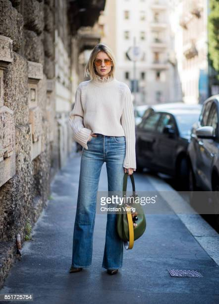 Lisa Hahnbueck wearing Golden Goose deluxe brand turtle neck Citizens of Humanity jeans MCM bag MCM Charm Balenciaga boots is seen during Milan...