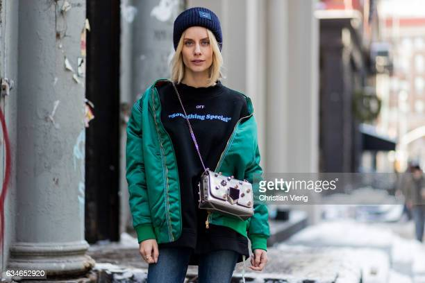 Lisa Hahnbueck wearing HILFIGER COLLECTION OVERSIZED BOMBER JACKET OFF WHITE PRINTED COTTON SWEATSHIRT JIMMY CHOO LOCKETT BAG ACNE PANSY BEANIE LOUIS...