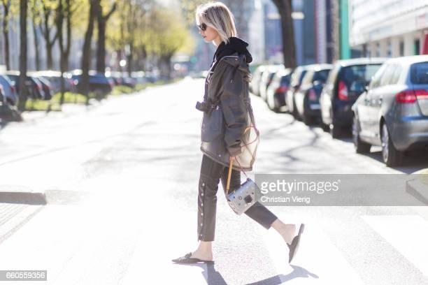 Lisa Hahnbueck wearing Hunter Raincoat Justin Bieber Purpose Tour Merchandise Sweatshirt Mango Cropped Leather Pants Alberta Ferretti Mules RayBan...