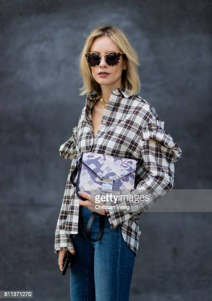Lisa Hahnbueck wearing J Brand jeans SJYP printed cotton blend shirt with statement sleeves Balenciaga x Colette knife boots limited edition Prada...