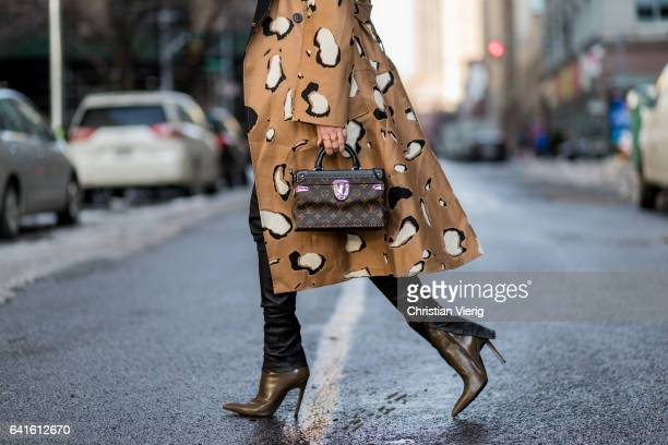 "Lisa Hahnbueck wearing Leopardspot cotton trench coat Bonvirage Leather Pants OffWhite ""Something Special"" Printed Cotton Sweatshirt Balenciaga Boots..."