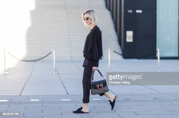 Lisa Hahnbueck wearing Louis Vuitton RTW Spring/ Summer 2017 Knit Pants Mango Mules JW Anderson Pierce Bag Prada Sunglasses on March 30 2017 in...