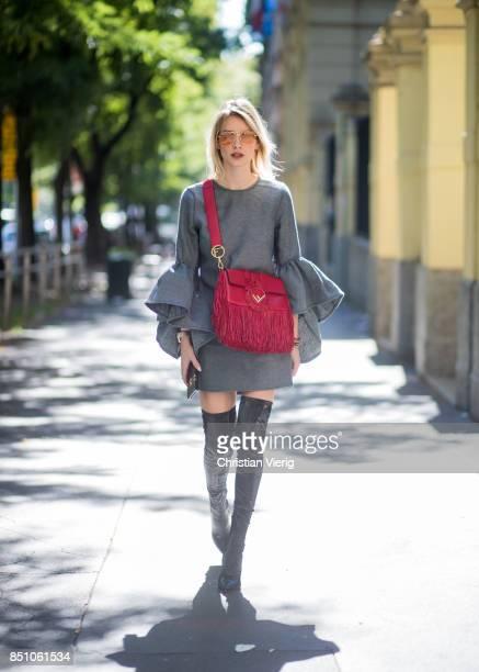 Lisa Hahnbueck wearing Marques Almeida ruffled sleeve dress Jimmy Choo Lorraine overknees red Fendi bag is seen during Milan Fashion Week...