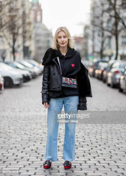 Lisa Hahnbueck wearing Maze Lambskin Jacket Play Comme de Garcon Sweatshirt Citizens of Humanity Jeans Prada Velvet Mules Fendi Clutch bag MCM Strap...