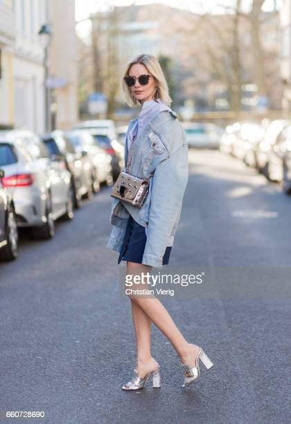 Lisa Hahnbueck wearing Off White Denim Jacket Zara Shirt Isla Asymmetric Laced Skirt gucci Heels Prada Sunglasses on March 30 2017 in Duesseldorf...