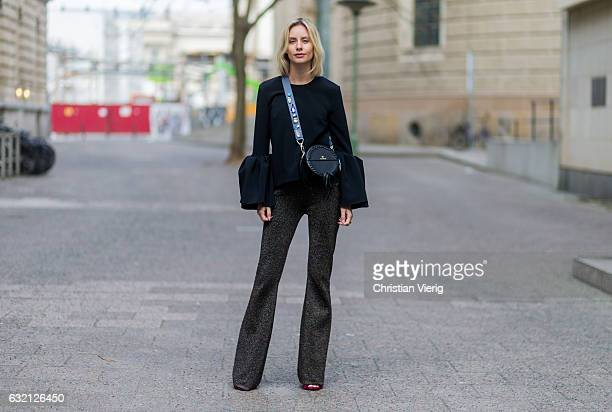 Lisa Hahnbueck wearing Roksanda âTruffautâ Top with Statement Cuffs/ Bell Sleeves Sandro Glitter Pants Aigner Tonga Bag Aigner Strap with Swarovski...