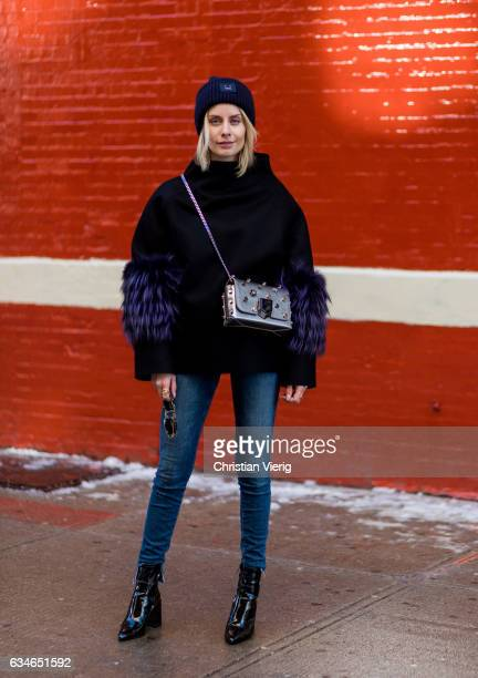 Lisa Hahnbueck wearing SAKS POTTS Black Felt Fox Fur Bille Jumper JBRAND Carolina HIGHWAIST JEANS ACNE PANSY BEANIE MANGO NAPLACK BOOTS JIMMY CHOO...