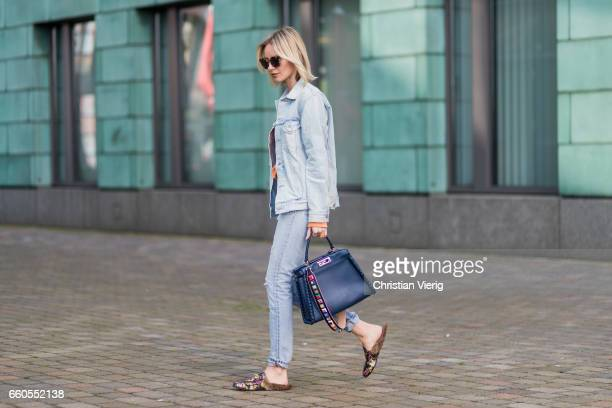 Lisa Hahnbueck wearing Sitzens of Humanity Denim Jacket Sitzens of Humanity Denim Jeans Gucci Princetown Loafer Fendi Peekaboo bag Fendi Studded...