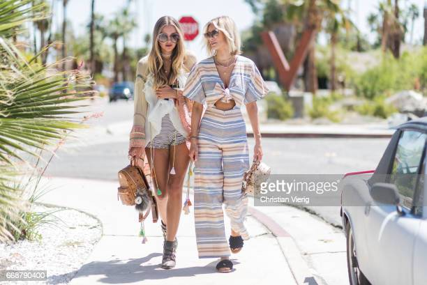 Lisa Hahnbueck wearing solid and striped jumpsuit Maxco fringe sandals MCM xmini backpack Fendi sunglasses and Nina Suess wearing Chloe top boots and...
