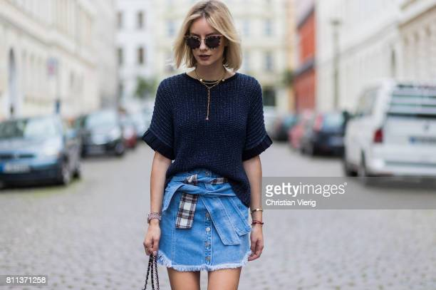 Lisa Hahnbueck wearing Strenese knit top SJYP denim skirt with belt details Christian Louboutin pink douce du desert high heels Prada sunglasses...