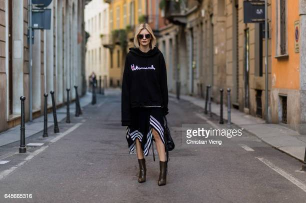 Lisa Hahnbueck wearing Vetements Sweatshirt Designers Remix draped rip knit Balenciaga Boots Balenciaga Motorcycle bag Prada Sunglasses during Milan...