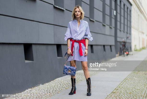 Lisa Hahnbueck wearing Victoria Beckham shirtdress with bow sleeves Anine Bind wrapped knit Christian Louboutin crazy boot army boot Louis Vuittion...