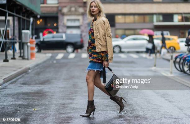 Lisa Hahnbueck wearing wearing mustard bomber jacket Missoni sweater cutted denim skirt JW Anderson bag ankle boots on September 6 2017 in New York...