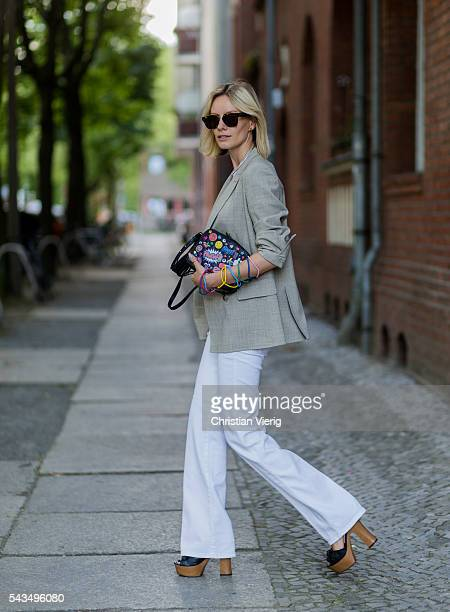 Lisa Hahnbueck wearing white pants from Closed black Anya Hindmarch bag heels from Guess and beige blazer Max Mara during the MercedesBenz Fashion...