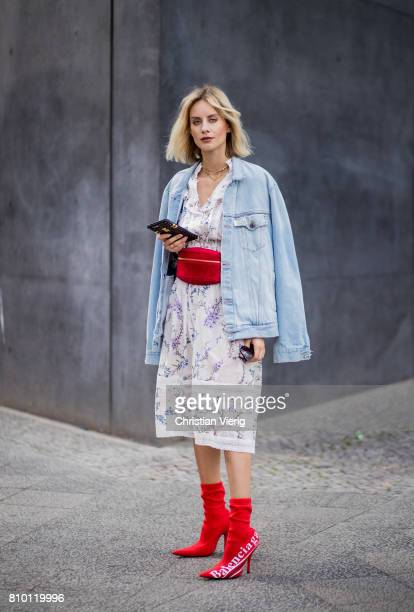 Lisa Hahnbueck wearing Zimmermann dress a denim jeans jacket Off White red vintage Chanel belt bag red Balenciaga x Colette Knife boots during the...