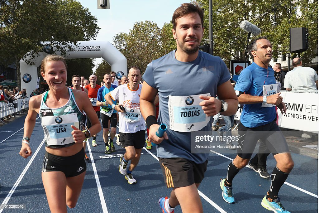Lisa Hahner (Marathon) of the BMW Wintersport relay hands over to her team mate Tobias Wendl (Ludge) during the 43. BMW Berlin Marathon on September 25, 2016 in Berlin, Germany.