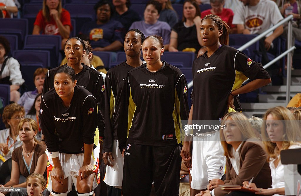 Lisa Harrison Angelina Williams Gwen Jackson Diana Taurasi and Ashley Robinson of the Phoenix Mercury look on from the sidelines during a WNBA game...