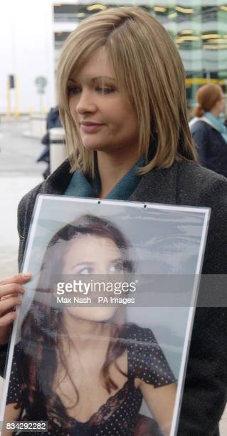 Lisa Hawker holds a photograph of her sister murdered British teacher Lindsay Ann Hawker from Brandon near Coventry at Heathrow's Terminal 3 before...