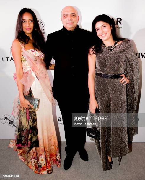 Lisa Haydon Tarun Tahiliani and Anaita Adjania Shroff attend the inaugural amfAR India event at the Taj Mahal Palace Mumbai on November 17 2013 in...