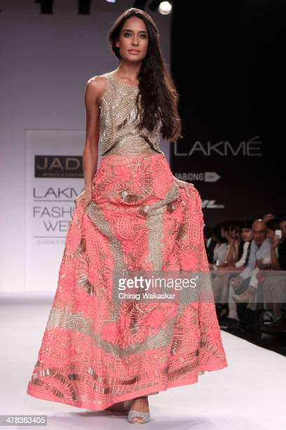 Lisa Haydon walks the runway wearing designs by Jade by Monica Karishma at day 3 of Lakme Fashion Week Summer/Resort 2014 at the Grand Hyatt on March...