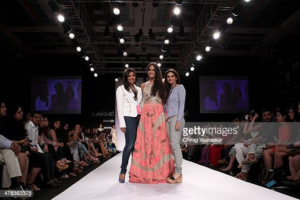 Lisa Haydon walks the runway with Monica Shah Karishma Swali at day 3 of Lakme Fashion Week Summer/Resort 2014 at the Grand Hyatt on March 13 2014 in...