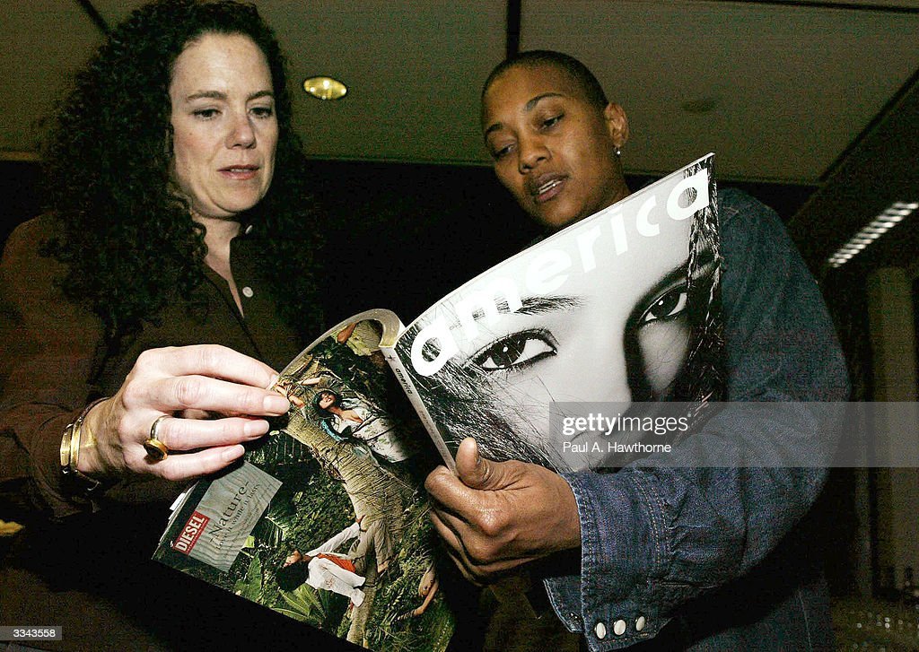 Lisa Hintelmann (L) and Robyn Crawford look at a copy of Damon Dash's new magazine 'New America' during a viewing of 'Baadasssss!' at the Sony Screening Room, April 12, 2004 in New York City.