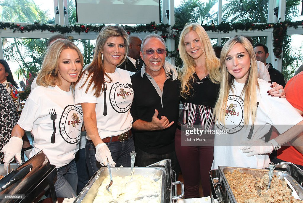 Lisa Hochstein, Ana Quincoces, Emilio Estefan, Alexia Echevarria and Marisol Patton participate in 5th Annual Thanksgiving Feed A Friend at Bongos on November 22, 2012 in Miami, Florida.