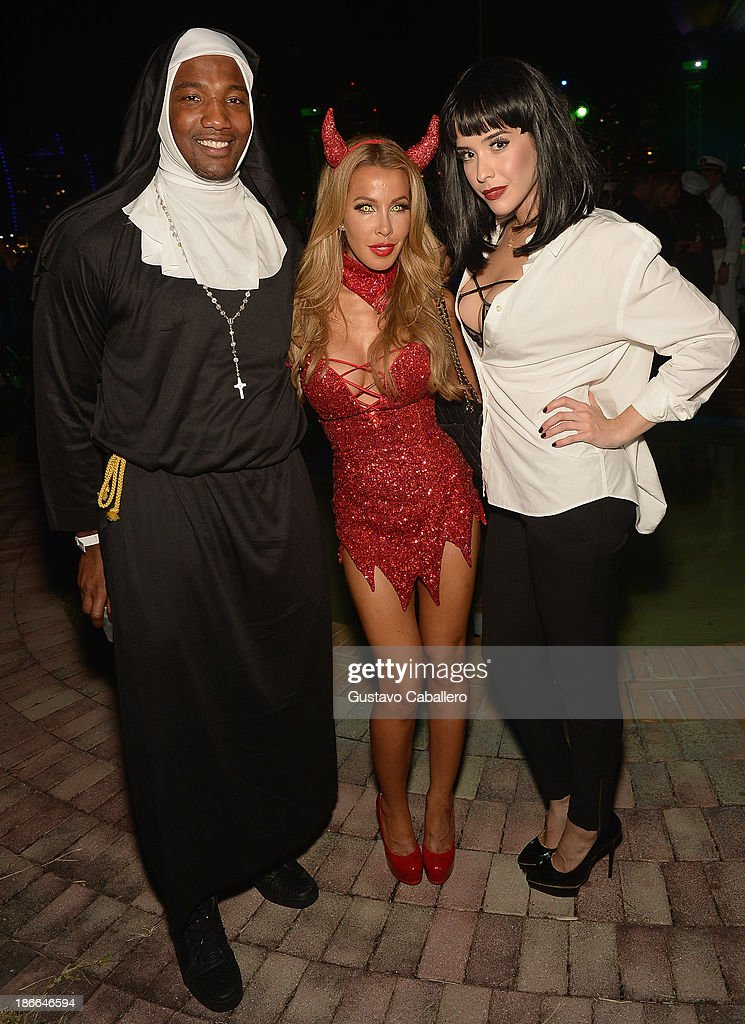 Lisa Hochstein and guests attend Lisa Hochstein of 'Real Housewives of Miami' and Lenny Hochstein's Halloween Ball benefitting the Make-A-Wish Foundation on November 1, 2013 in Miami Beach, Florida.