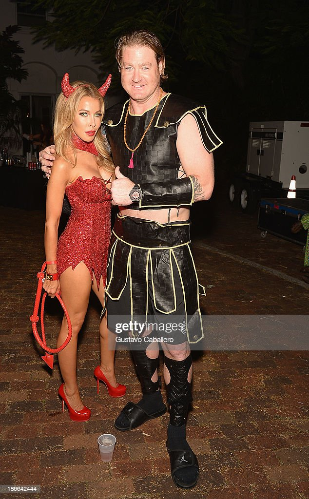Lisa Hochstein and Jeremy Shockey attend Lisa Hochstein of 'Real Housewives of Miami' and Lenny Hochstein's Halloween Ball benefitting the Make-A-Wish Foundation on November 1, 2013 in Miami Beach, Florida.