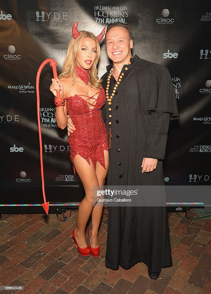 Lisa Hochstein and Lenny Hochstein attend Lisa Hochstein of 'Real Housewives of Miami' and Lenny Hochstein's Halloween Ball benefitting the Make-A-Wish Foundation on November 1, 2013 in Miami Beach, Florida.