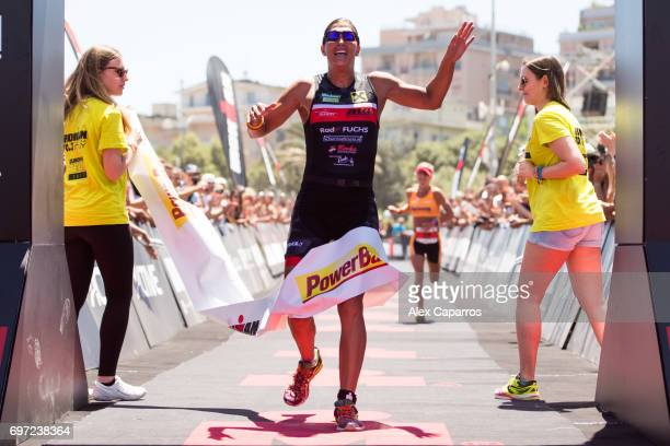 Lisa Huetthaler of Austria celebrates as she finishes in 1st position Ironman 703 Italy race on June 18 2017 in Pescara Italy