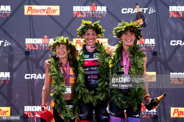 Lisa Huetthaler of Austria in 1st place Camilla Lindholm Borg of Sweden in 2nd place and Tine Deckers of Belgium in 3rd place celebrate their...