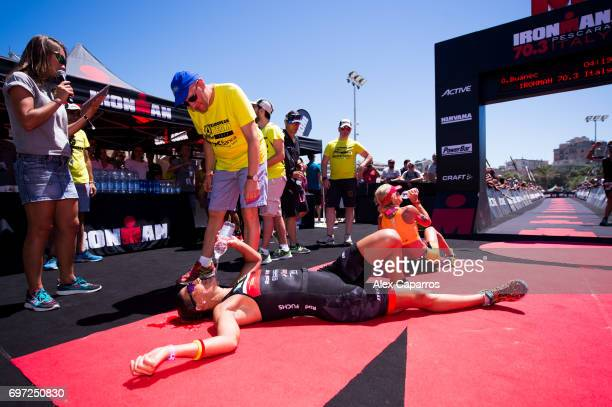 Lisa Huetthaler of Austria reacts after finishing in 1st position in the Ironman 703 Italy race on June 18 2017 in Pescara Italy