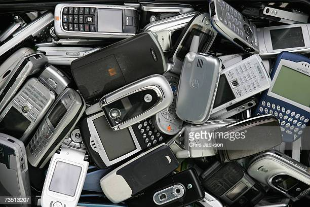 DJ Lisa I'Anson poses with old mobile phones as she lauches a new Somerfield mobile phone recycling campaign on March 7 2007 in London England For...