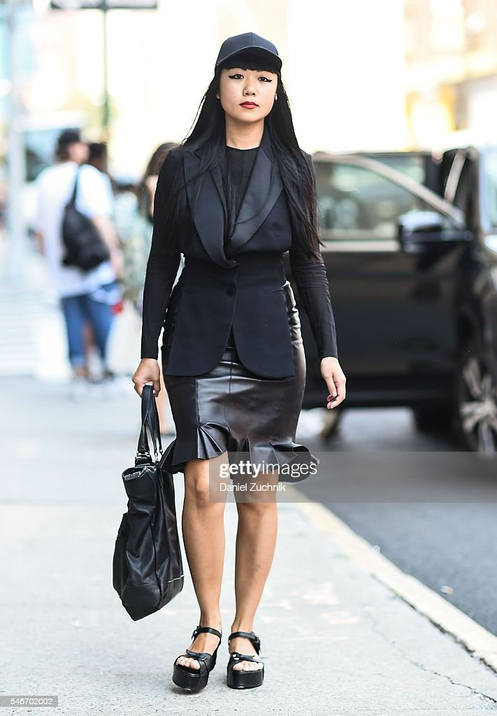 Lisa is seen outside the Robert Geller show wearing Louis Vuitton jacket Chanel skirt and Givenchy bag during New York Fashion Week Men's S/S 2017...
