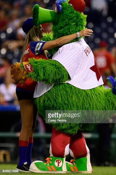 Lisa Jarrell hugs the Phillie Phanatic between the Philadelphia Phillies and the Oakland Athletics at Citizens Bank Park on September 16 2017 in...