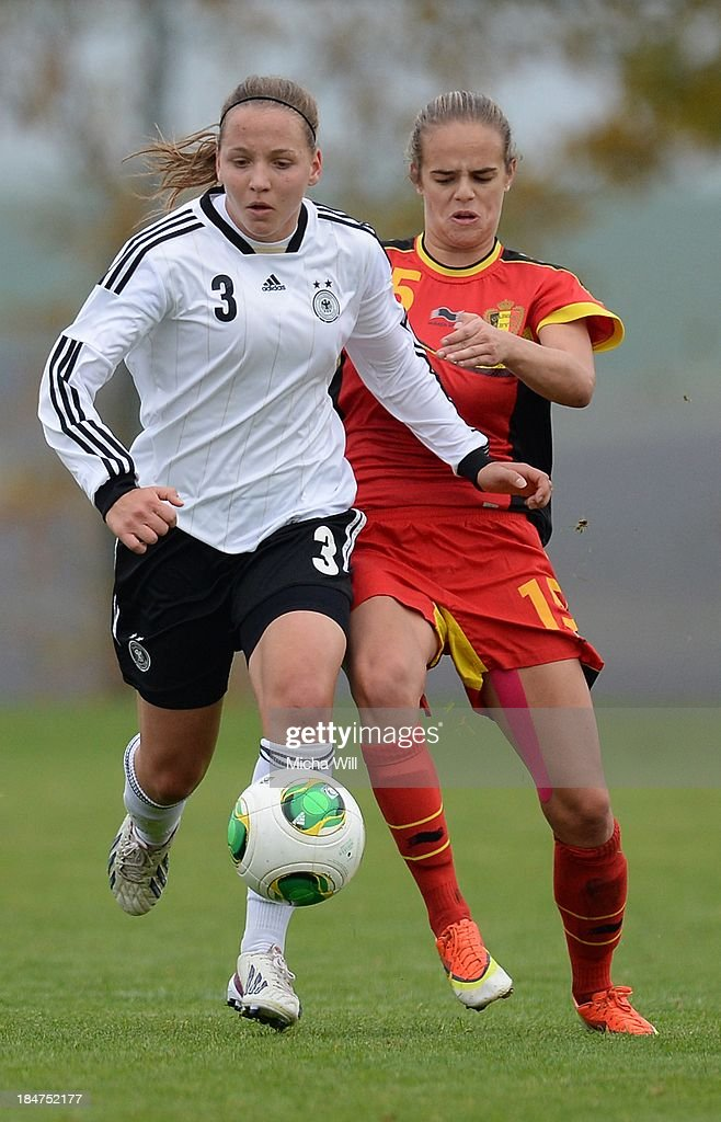 Lisa Karl (L) of Germany and Amber Maximus of Belgium compete for the ball during the U17 Girls Euro Qualifier match between Germany and Belgium at Bioenergie-Arena on October 16, 2013 in Grossbardorf, Germany.