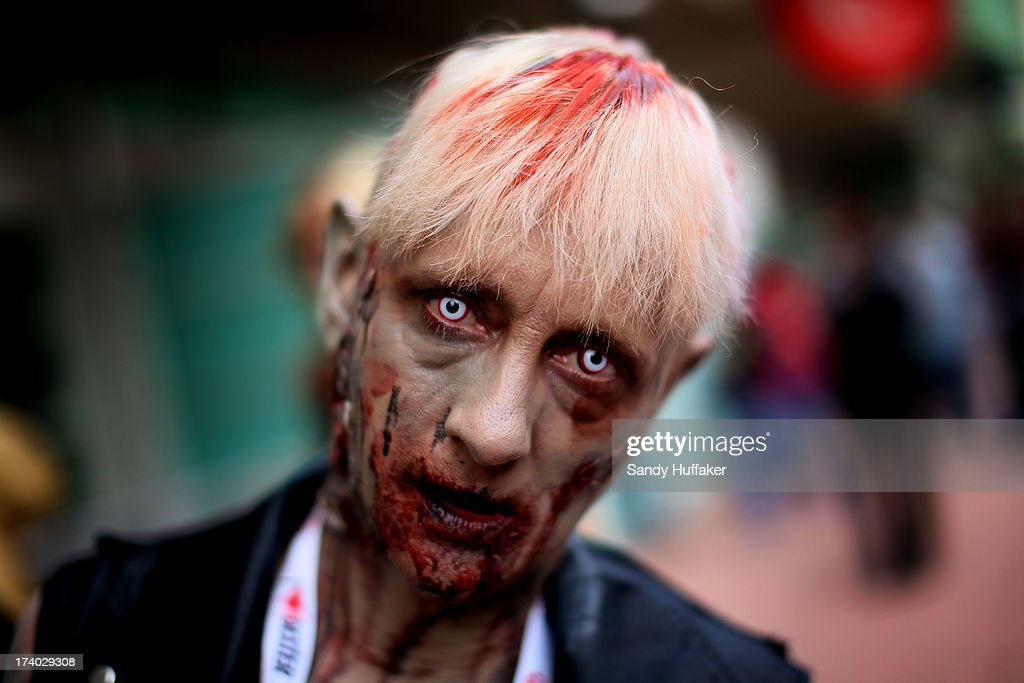 Lisa Kruis shows her zombie outfit at Comic Con at the San Diego Convention Center on July 19, 2013 in San Diego, California. Comic Con International Convention is the world's largest comic and entertainment event and hosts celebrity movie panels, a trade floor with comic book, science fiction and action film-related booths, as well as artist workshops and movie premieres.