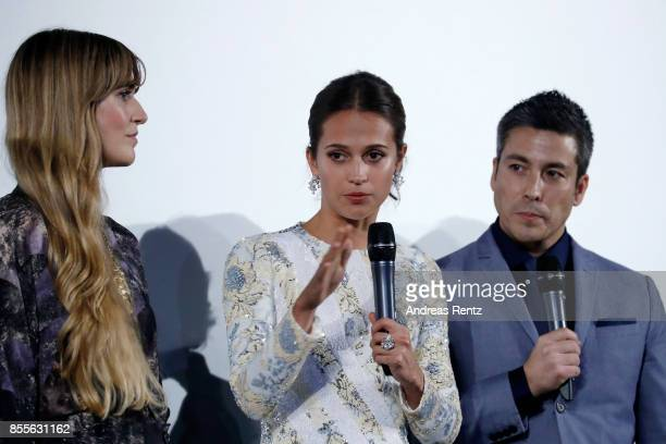 Lisa Langseth Alicia Vikander and moderator Max Loong speak on stage at the 'Euphoria' premiere during the 13th Zurich Film Festival on September 29...