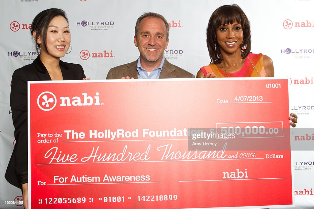 Lisa Lee, Director of Marketing and Communications, Fuhu Inc., Jim Mitchell, CEO Fuhu Inc., and <a gi-track='captionPersonalityLinkClicked' href=/galleries/search?phrase=Holly+Robinson+Peete&family=editorial&specificpeople=213716 ng-click='$event.stopPropagation()'>Holly Robinson Peete</a> gather for a donation on behalf of nabi to the HollyRod Foundation to help families living with autism at Fuhu, Inc. on April 7, 2013 in Los Angeles, California.