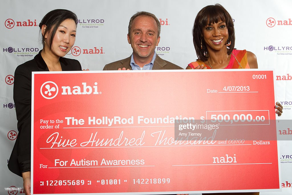 Lisa Lee, Director of Marketing and Communications, Fuhu Inc., Jim Mitchell, CEO Fuhu Inc., and Holly Robinson Peete gather for a donation on behalf of nabi to the HollyRod Foundation to help families living with autism at Fuhu, Inc. on April 7, 2013 in Los Angeles, California.