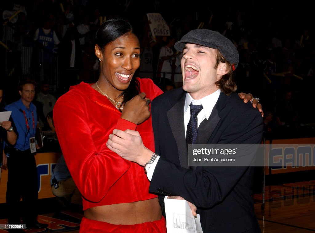 Lisa Leslie and Ashton Kutcher during 2004 NBA All-Star Celebrity Game at Los Angeles Convention Center in Los Angeles, California, United States.